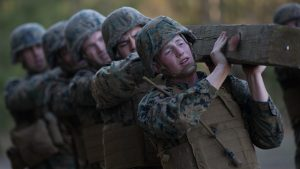 CAMP LEJUENE, NC - U.S. Marines with 8th Marine Regiment, 2nd Marine Division execute log-lifts as part of combat conditioning exercises on Camp Lejeune, N.C., March 23, 2018. The Marines performed the exercises to improve upon both their physical and mental strength.